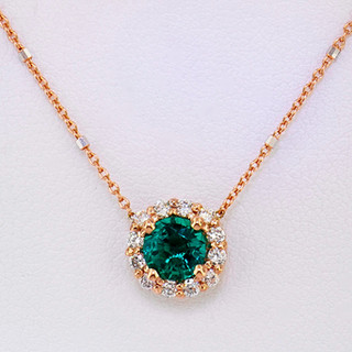 14k two-tone, white and rose gold, .24ct total weight diamond halo, 1ct chrome diopside center stone