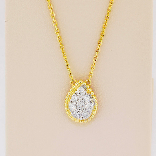 14k two-tone yellow and white gold, .43ct total weight diamond pendant
