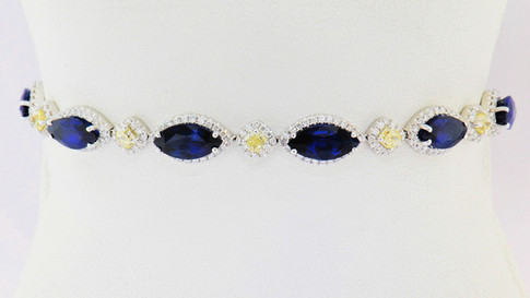 1.63ct total weight fancy yellow diamonds, 1.72ct total weight diamonds, 12.58ct total weight blue sapphire set in 18k white gold bracelet