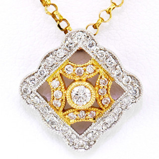 18k two tone, yellow and white gold .30ct total weight, diamond pendant