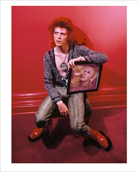 """David Bowie With Hunky Dory Album Cover Haddon Hall © Mick Rock  11""""x14"""" $1,500 USD (limited edition of 90)  16""""x20"""" $2,500 USD (limited edition of 90)  20""""x24"""" $3,000 USD (limited edition of 50)  24""""x30"""" $4,700 USD (limited edition of 35)  30""""x40"""" $8,500 USD (limited edition of 25)  40""""x60"""" $15,000 USD (limited edition of 10)"""