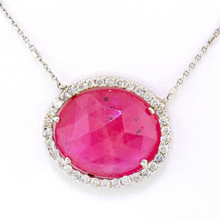 14k white gold .51ct total weight total weight diamond frame, pink sapphire center