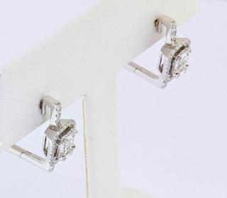 18k white gold 4.09 ct diamond earrings