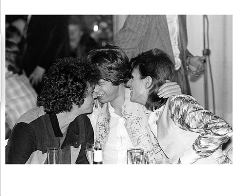 """Lou Reed Mick Jagger David Bowie Cuddling Cafe Royal London 1973 2024 © Mick Rock  11""""x14"""" $1,200 USD (limited edition of 90)  16""""x20"""" $2,000 USD (limited edition of 90)  20""""x24"""" $2,500 USD (limited edition of 50)  24""""x30"""" $4,000 USD (limited edition of 35)  30""""x40"""" $7,000 USD (limited edition of 25)  40""""x60"""" $12,000 USD (limited edition of 10)"""