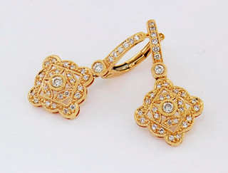 18k rose gold .35ct total weight diamond earrings