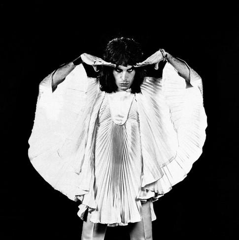 "Freddie Mercury White Tunic Black Background London 1974 © Mick Rock  11""x14"" $1,200 USD (limited edition of 90)  16""x20"" $2,000 USD (limited edition of 90)  20""x24"" $2,500 USD (limited edition of 50)  24""x30"" $4,000 USD (limited edition of 35)  30""x40"" $7,000 USD (limited edition of 25)  40""x60"" $12,000 USD (limited edition of 10)"