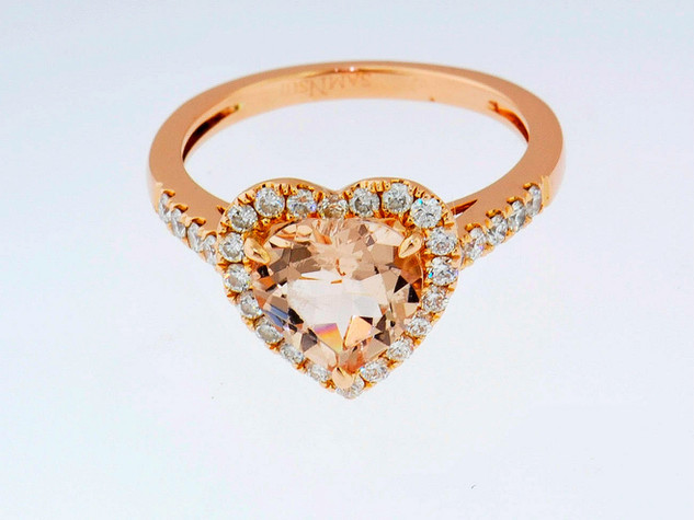 14k rose gold .45ct total weight in diamonds. Morganite center stone