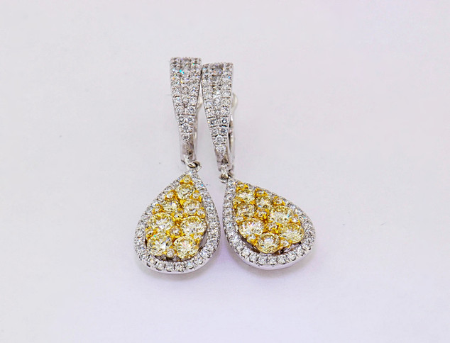 18k white gold 1.31ct total weight yellow diamonds, .67ct total weight white diamonds, pear shaped earrings
