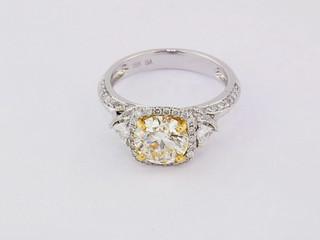 18k two-tone, white and yellow gold .72ct total weight diamond setting, 1ct diamond center stone