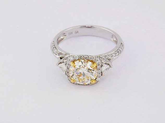 18k two-tone, white and yellow gold .72ct total weight diamond setting, 1ct diamond center stone