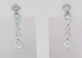 14k white gold .50ct total weight, diamond earrings