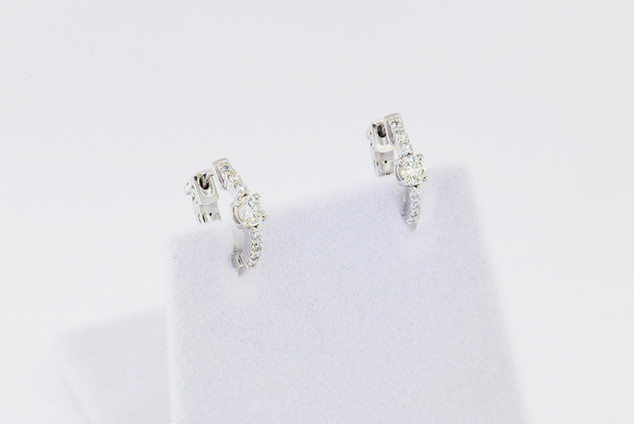 14k white gold, .58ct total weight round diamond prong set earrings.