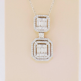 18k white gold, 1.14 baguettes/rounds, micro pavé and invisible setting pendant.