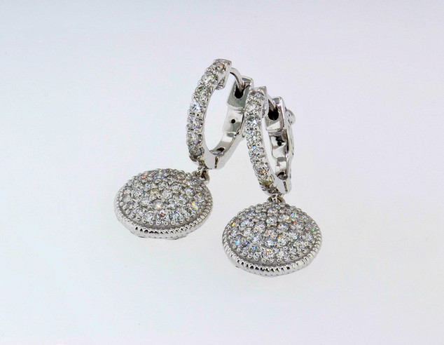 14k white gold earring containing 1.21ct in diamonds total