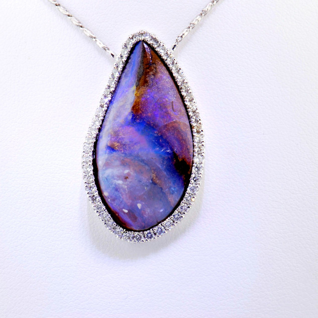 14k white gold Boulder opal with .75ct diamond border