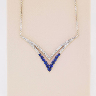 14k white gold, .25ct sapphire, .14t total weight diamond micro pavé and prong set necklace.