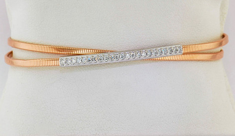 14k two-tone, white and rose gold .27ct total weight diamond bangle bracelet