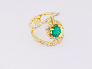 14k yellow gold, 1.29ct emerald, .76ct total weight diamond ring