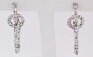 14k white gold 1.63ct total weight diamond earrings. Removable hoops allow multiple styling options for this earring