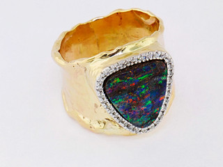 14k yellow gold .32ct total weight diamond frame with opal center stone