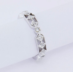 18k white, .19ct total weight, bead and bezel set, miligrain