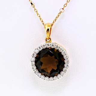 18k rose gold pendant, .24ct total weight, in diamonds. Smokey topaz center stone
