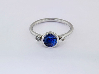 14k white gold .14ct total weight diamond 1.09ct total weight sapphire ring