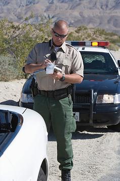 Officer giving a speeding ticket