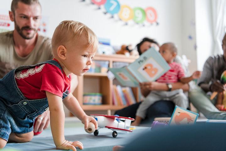 Little boy playing in a classroom.jpg