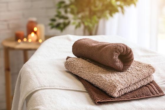 Towels on massage table in spa salon.jpg