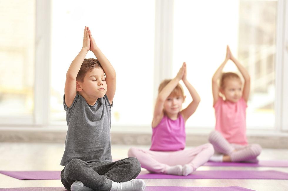 Group of children doing gymnastic exerci
