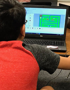 Child in computer class