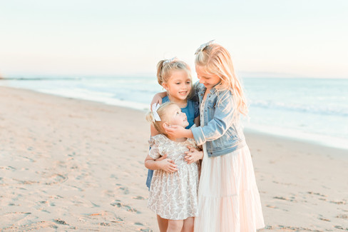 sisters-hug-shell-beach.jpg