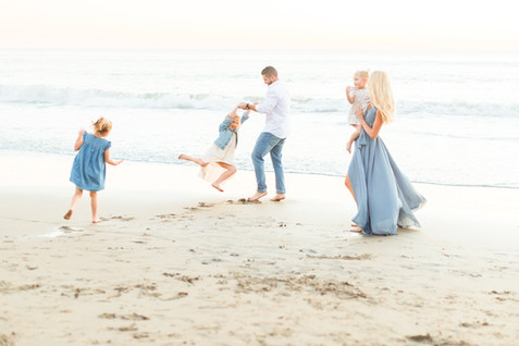 family-playing-shell-beach.jpg