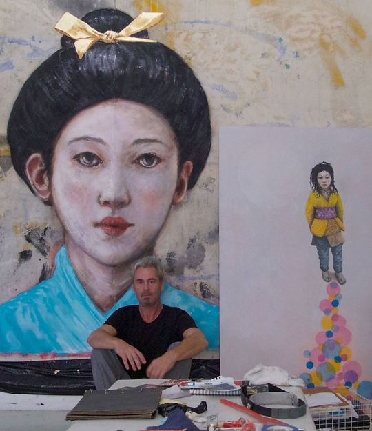 Tobias Keene in his studio, with 'Geisha Girl' and 'Girl in the Yellow Vest'