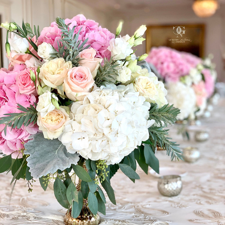 Low hydrangea wedding centerpieces in blush ivory and pink color