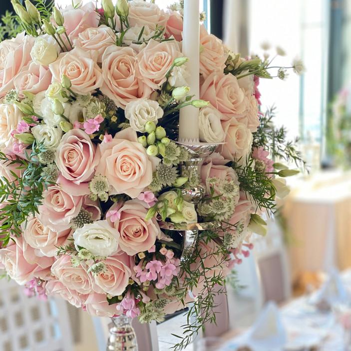 Romantic blush wedding reception flowers