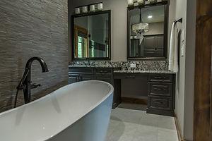 bathroom with standing bathtub