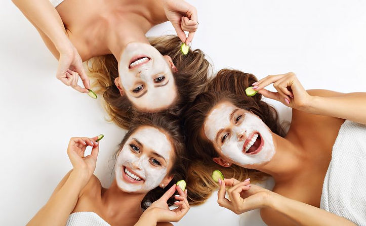 Girls having fun with facemasks on at a pamper party