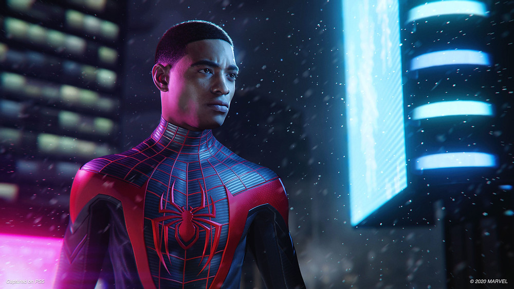 Miles Morales Stands in Front of Buildings
