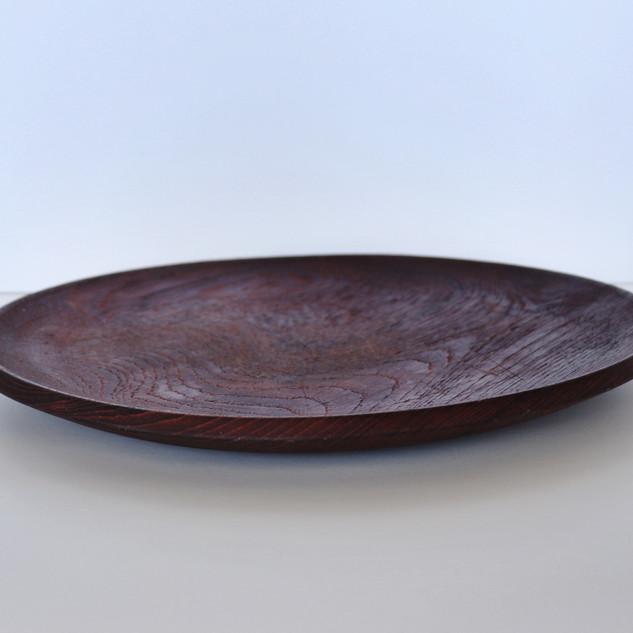 round dark wood platter