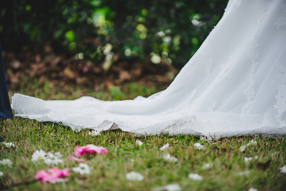 spring flowers on grass with wedding dress train