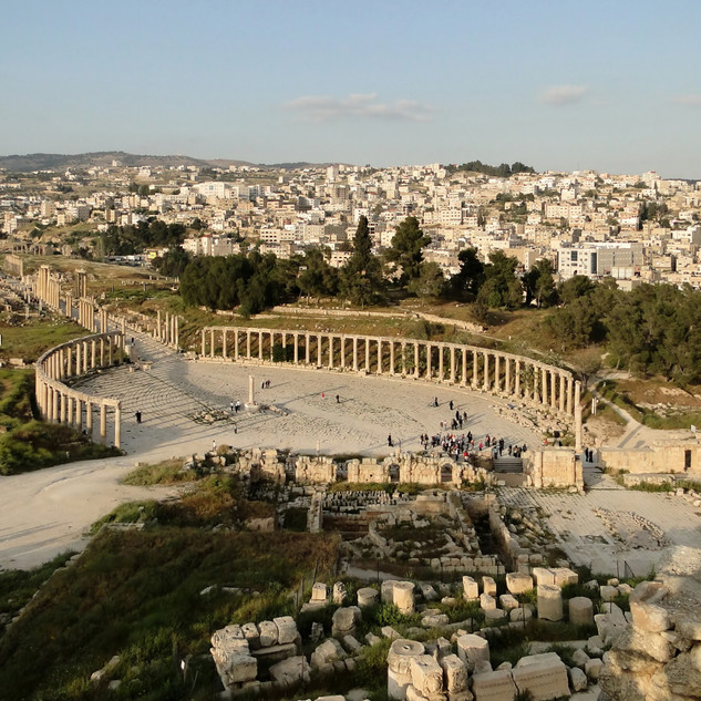 Jerash ruins in the foreground and modern Jerash city in the background