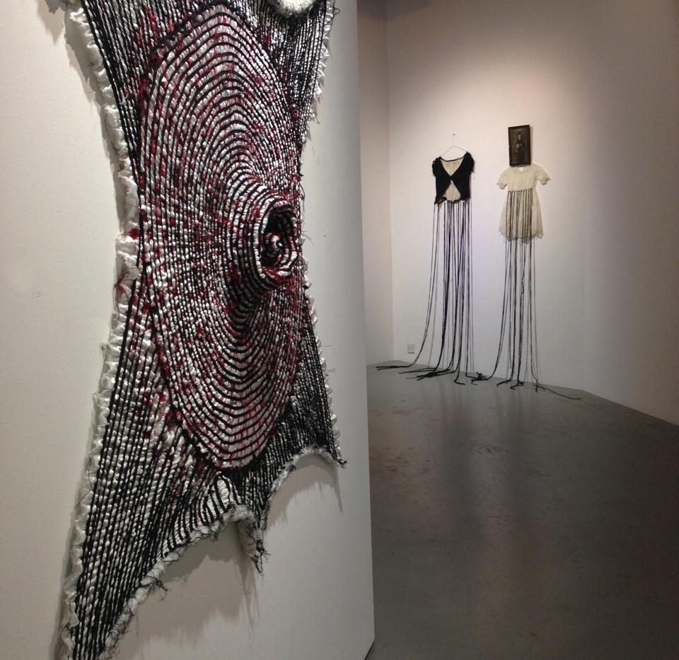 Front: Maryam Ashkanian Epitome serie Sewing on fabric 120 x 120 cm 2013  Back: Cecilia Monero-Yaghoubi Empty dress 2011