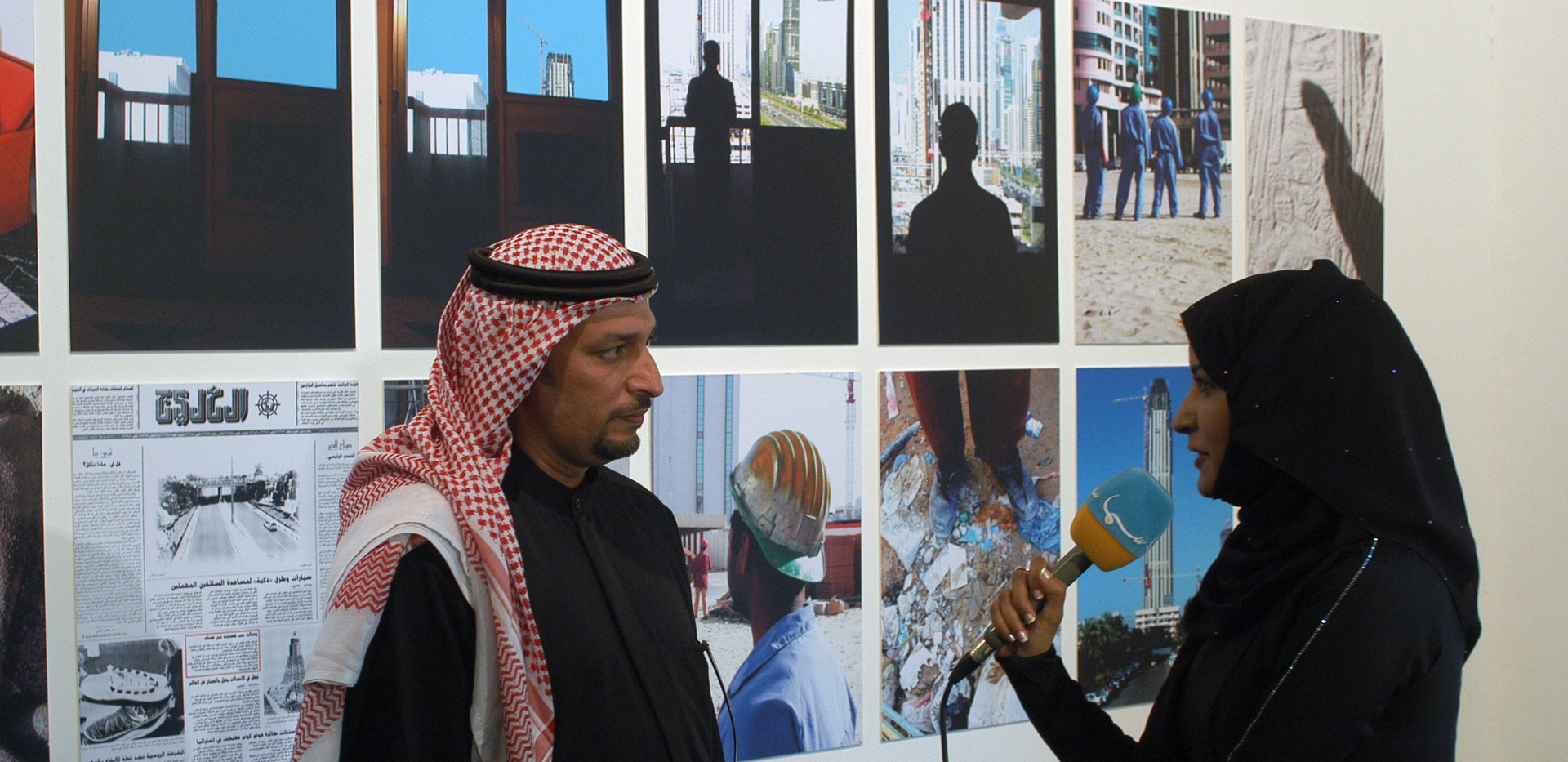 Mohammed Kazem in front of his work