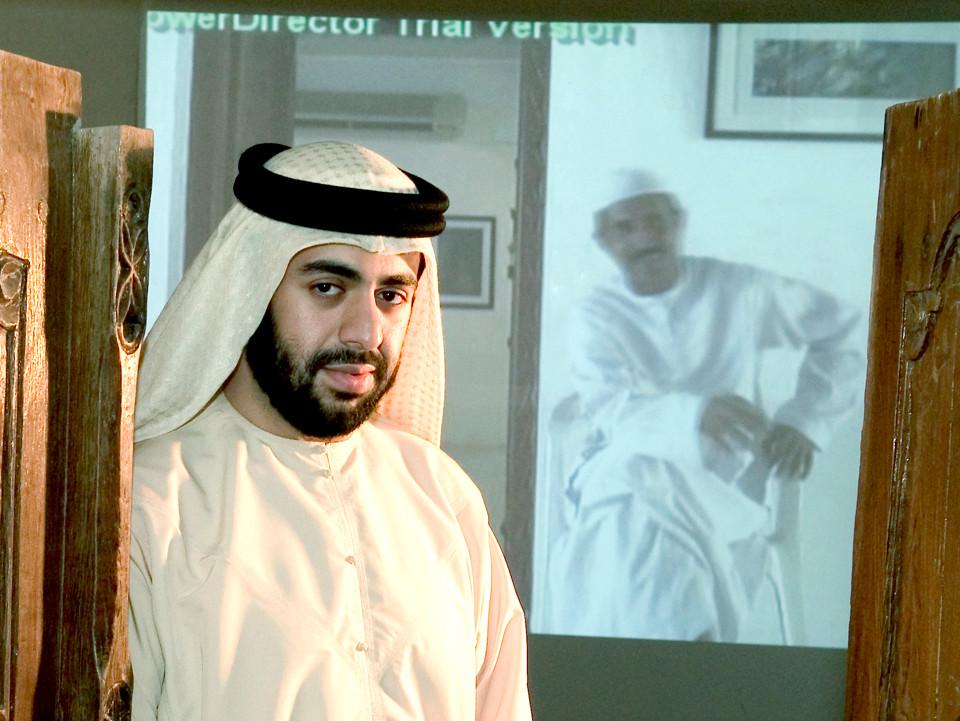 Nasser Abdulla in front of his work