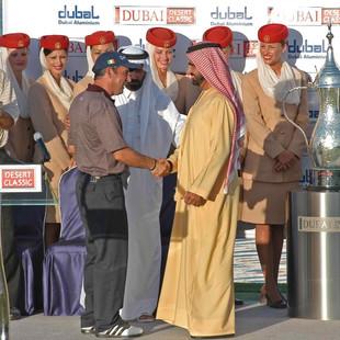 His Highness Sheikh Mohammed bin Rashid Al Maktoum, Vice President of the UAE and Ruler of Dubai, issuing the Dubai Desert Classic winning trophy to golfer Mark O'Meara