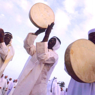 Emirati men performing a traditional dance with drums
