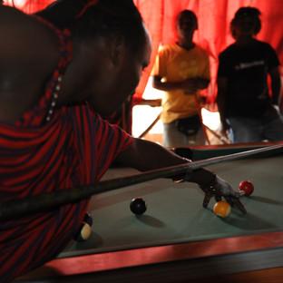 Masai playing pool