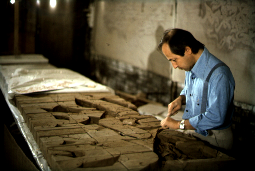Mohammad Ehsai at work Ceramic relief for his mural 1980s